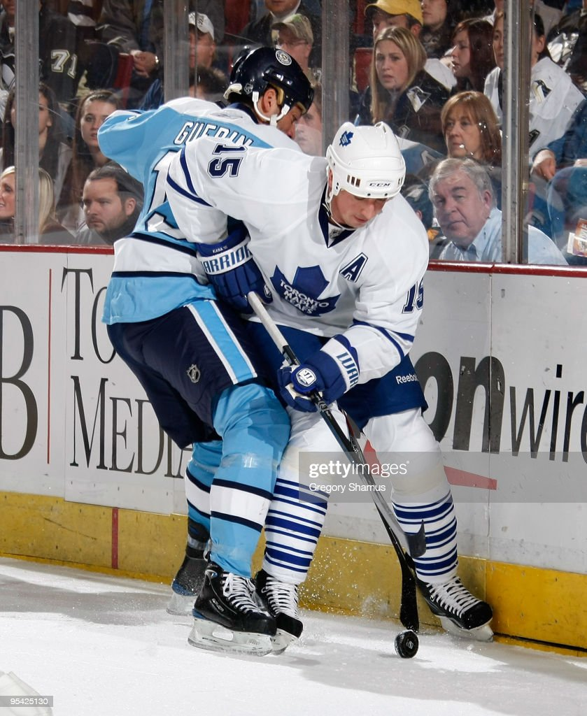 Tomas Kaberle of the Toronto Maple Leafs battles for the puck against Bill Guerin of the Pittsburgh Penguins on December 27 2009 at Mellon Arena in...
