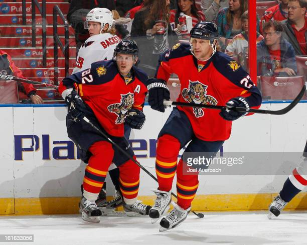 Tomas Kopecky and Alexei Kovalev of the Florida Panthers skate towards the Washington Capitals net at the BBT Center on February 12 2013 in Sunrise...
