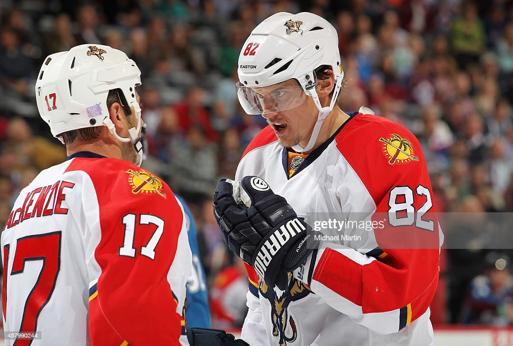 Tomas Kopecky and Derek MacKenzie of the Florida Panthers skates talk during a time out against the Colorado Avalanche at the Pepsi Center on October...