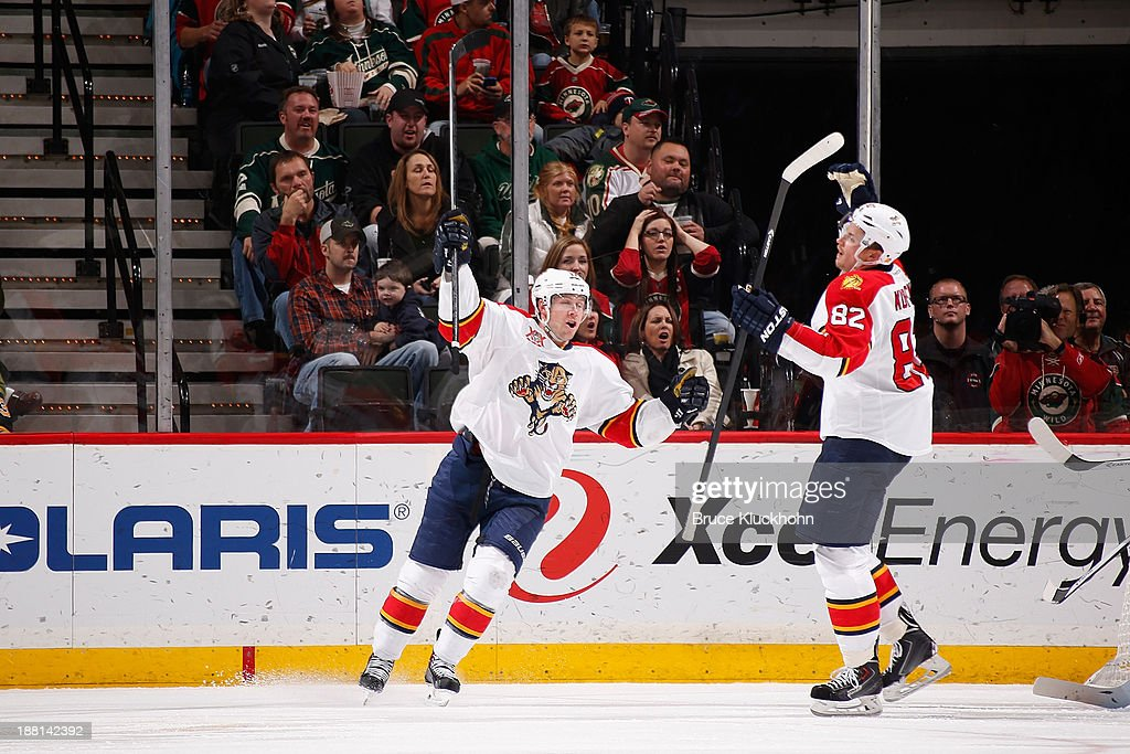 Tomas Kopecky #82 and Jesse Winchester #17 of the Florida Panthers celebrate Kopecky's goal in the third period against the Minnesota Wild on November 15, 2013 at the Xcel Energy Center in St. Paul, Minnesota.