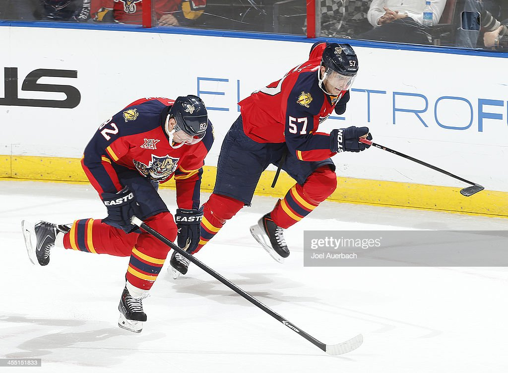 Tomas Kopecky #82 and Marcel Goc #57 of the Florida Panthers rush up ice near the end of regulation play against the Detroit Red Wings at the BB&T Center on December 10, 2013 in Sunrise, Florida. The Panthers defeated the red Wings 3-2 in a shootout.