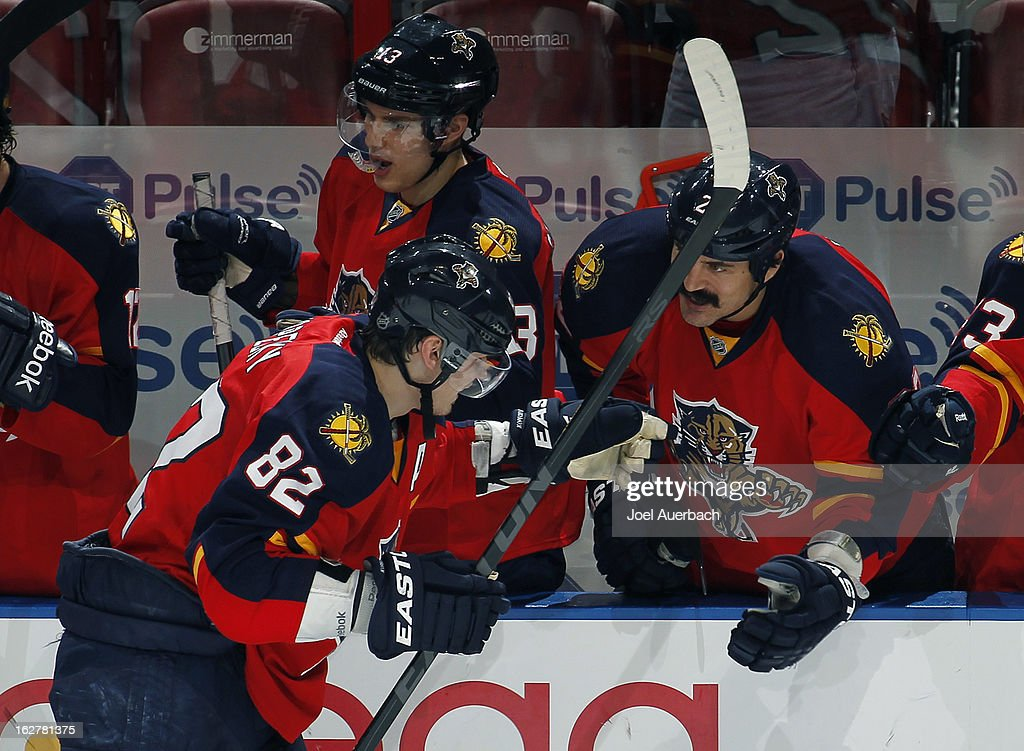 Tomas Kopecky #82 is congratulated by George Parros #22of the Florida Panthers after completing his hat trick against the Pittsburgh Penguins at the BB&T Center on February 26, 2013 in Sunrise, Florida. The Panthers defeated the Penguins 6-4.