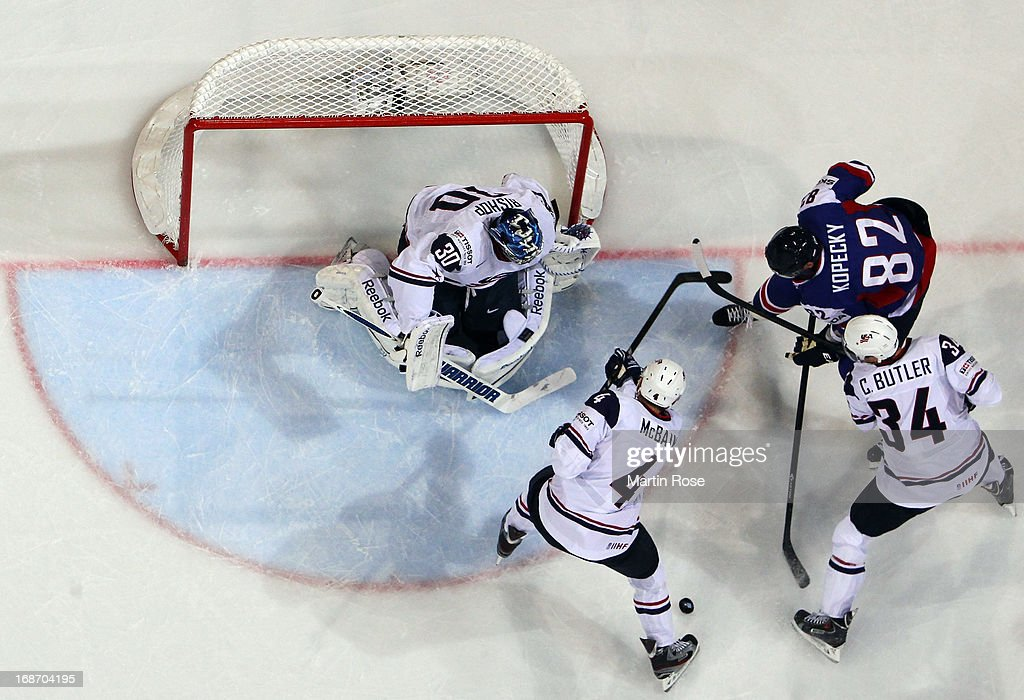 Tomas Kopecky (#82) of Slovakia and CHris Butler (#34) of USA battle for the puck during the IIHF World Championship group H match between Slovakia and USA at Hartwall Areena on May 14, 2013 in Helsinki, Finland.