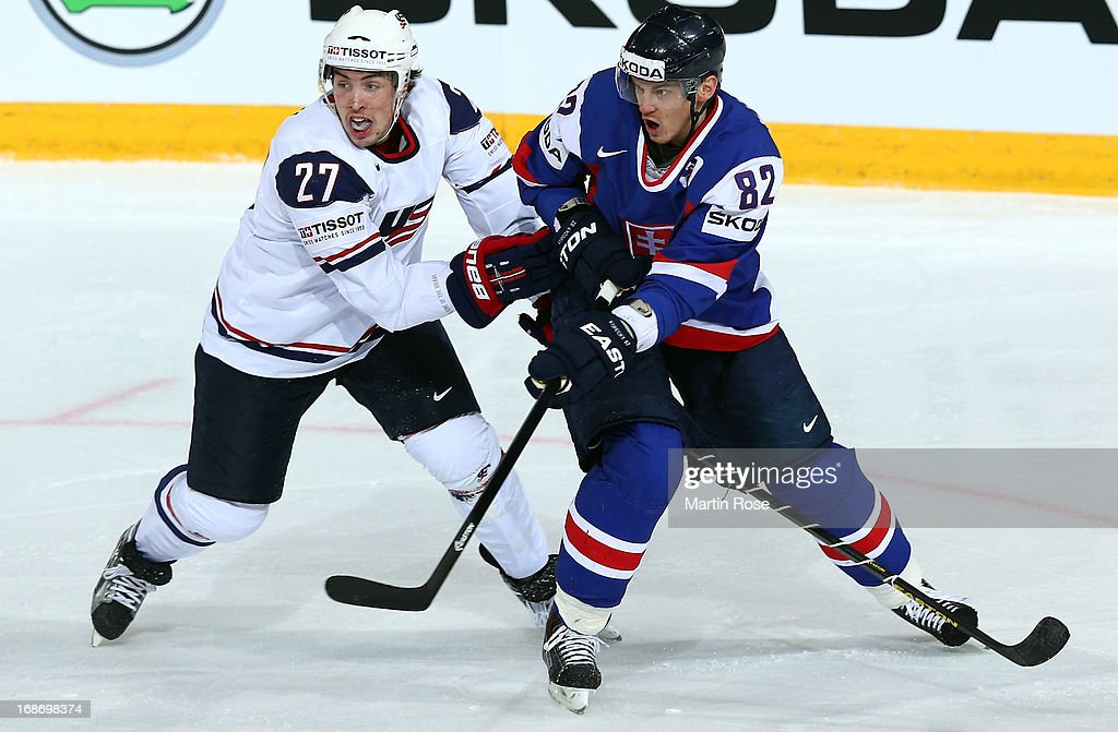 Tomas Kopecky (L) of Slovakia and Justin Faulk (R) of USA battle for the puck during the IIHF World Championship group H match between Slovakia and USA at Hartwall Areena on May 14, 2013 in Helsinki, Finland.