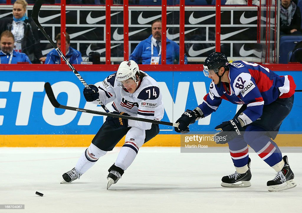 Tomas Kopecky (R) of Slovakia and TJ Oshie (L) of USA battle for the puck during the IIHF World Championship group H match between Slovakia and USA at Hartwall Areena on May 14, 2013 in Helsinki, Finland.