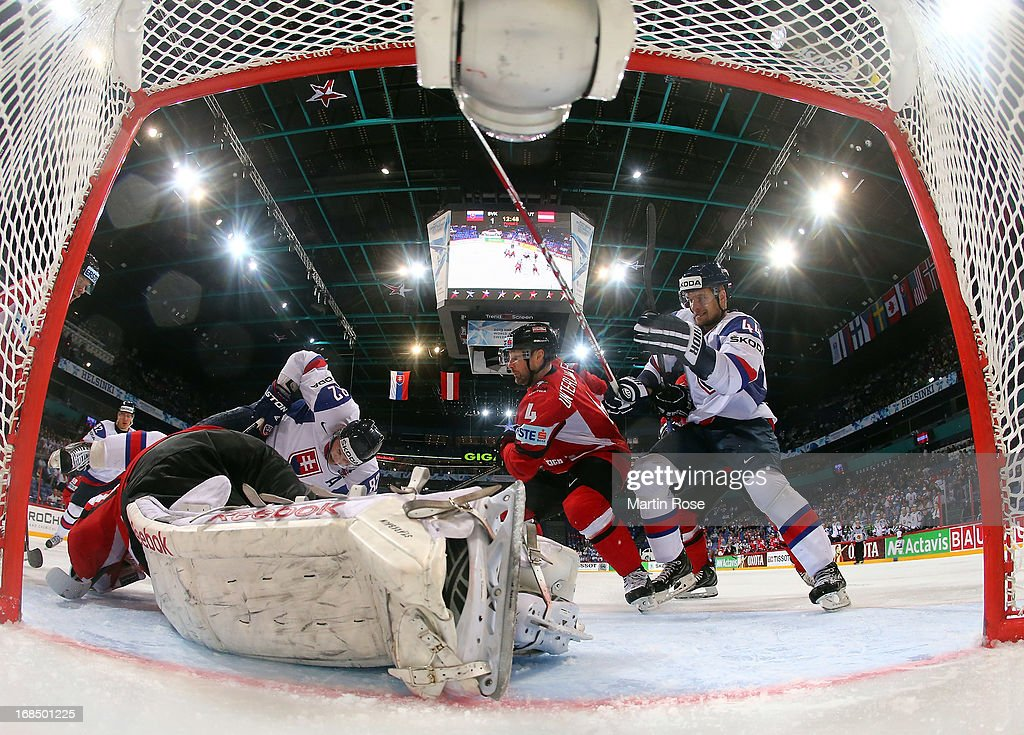 Tomas Kopecky (##82) of Slovakia fails to score over Bernhard Starkbaum (L), goaltender of Austria during the IIHF World Championship group H match between Slovakia and Austria at Hartwall Areena on May 10, 2013 in Helsinki, Finland.