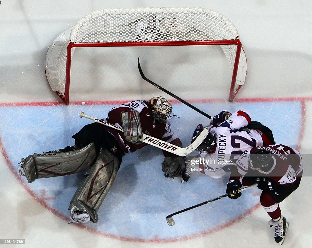 Tomas Kopecky (#82) of Slovakia fails to score over Kristers Gudlevskis (#50), goaltender of Latvia during the IIHF World Championship group H match between Russia and France at Hartwall Areena on May 9, 2013 in Helsinki, Finland.