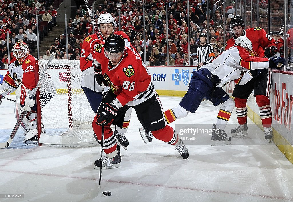 <a gi-track='captionPersonalityLinkClicked' href=/galleries/search?phrase=Tomas+Kopecky&family=editorial&specificpeople=2234349 ng-click='$event.stopPropagation()'>Tomas Kopecky</a> #82 of the Chicago Blackhawks and <a gi-track='captionPersonalityLinkClicked' href=/galleries/search?phrase=Alexander+Sulzer&family=editorial&specificpeople=673531 ng-click='$event.stopPropagation()'>Alexander Sulzer</a> #2 of the Florida Panthers skate after the puck as Panthers' goalie <a gi-track='captionPersonalityLinkClicked' href=/galleries/search?phrase=Tomas+Vokoun&family=editorial&specificpeople=202179 ng-click='$event.stopPropagation()'>Tomas Vokoun</a> #29 watches from behind and <a gi-track='captionPersonalityLinkClicked' href=/galleries/search?phrase=Troy+Brouwer&family=editorial&specificpeople=4155305 ng-click='$event.stopPropagation()'>Troy Brouwer</a> #22 of the Blackhawks watches from the boards on March 23, 2011 at the United Center in Chicago, Illinois.