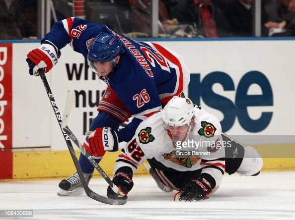 Tomas Kopecky of the Chicago Blackhawks and Erik Christensen of the New York Rangers battle for the puck at Madison Square Garden on November 1 2010...