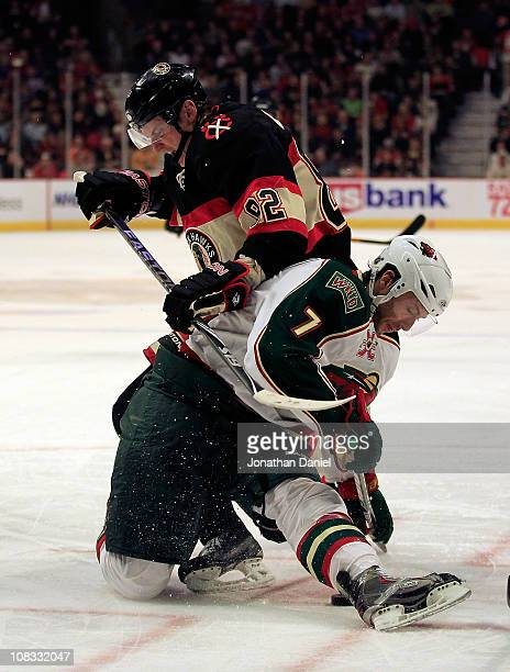 Tomas Kopecky of the Chicago Blackhawks and Matt Cullen of the Minnesota Wild battle for the puck after a faceoff at the United Center on January 25...