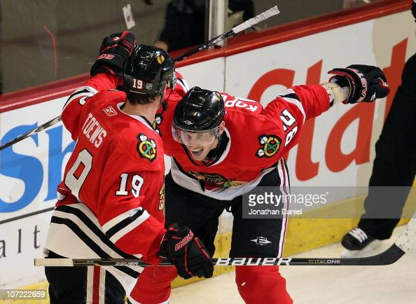 Tomas Kopecky of the Chicago Blackhawks celebrates a goal by teammate Jonathan Toews in the 3rd period against the St Louis Blues at the United...