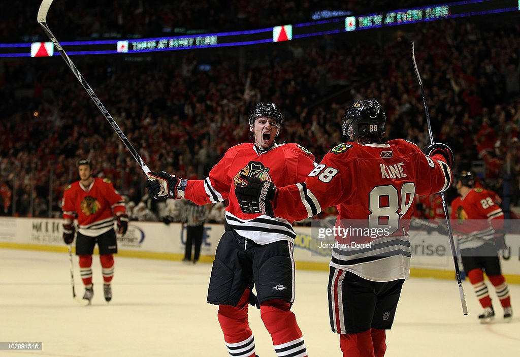 Tomas Kopecky of the Chicago Blackhawks celebrates his 2nd period goal with teammate Patrick Kane against the Dallas Stars at the United Center on...
