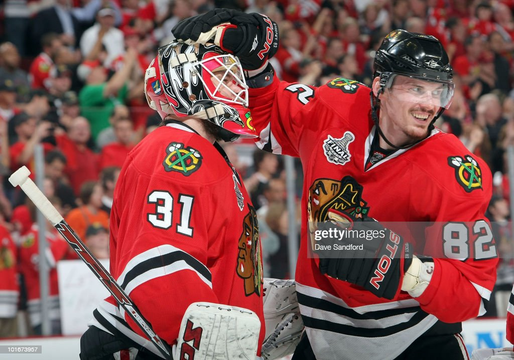 Tomas Kopecky #82 of the Chicago Blackhawks celebrates their 7-4 win with goaltender Antti Niemi #31 after Game Five of the 2010 NHL Stanley Cup Finals against the Philadelphia Flyers at United Center on June 6, 2010 in Chicago, Illinois.