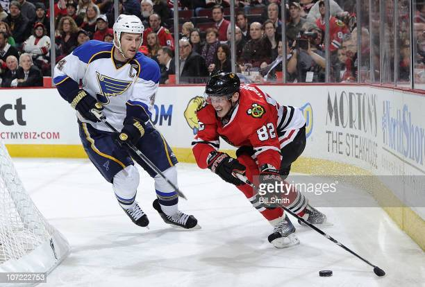 Tomas Kopecky of the Chicago Blackhawks gets in position to grab the puck as Eric Brewer of the St Louis Blues approaches from the side on November...