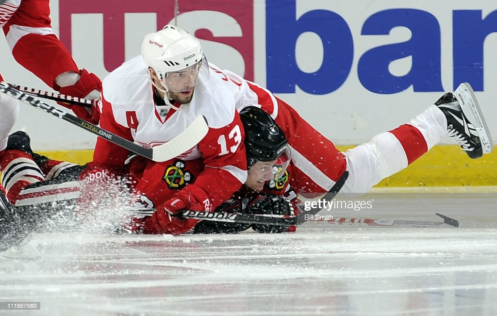 <a gi-track='captionPersonalityLinkClicked' href=/galleries/search?phrase=Tomas+Kopecky&family=editorial&specificpeople=2234349 ng-click='$event.stopPropagation()'>Tomas Kopecky</a> #82 of the Chicago Blackhawks gets squished by <a gi-track='captionPersonalityLinkClicked' href=/galleries/search?phrase=Pavel+Datsyuk&family=editorial&specificpeople=202893 ng-click='$event.stopPropagation()'>Pavel Datsyuk</a> #13 of the Detroit Red Wings on April 10, 2011 at the United Center in Chicago, Illinois.