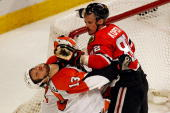Tomas Kopecky of the Chicago Blackhawks hits Daniel Carcillo of the Philadelphia Flyers in the face in the first period of Game Two of the 2010 NHL...