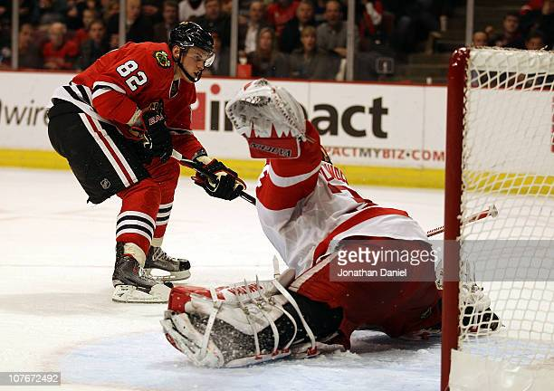 Tomas Kopecky of the Chicago Blackhawks scores a goal against Jimmy Howard of the Detroit Red Wings in the 2nd period at the United Center on...