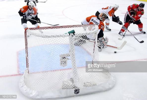 Tomas Kopecky of the Chicago Blackhawks scores the gamewinning goal against goaltender Brian Boucher of the Philadelphia Flyers in Game One of the...