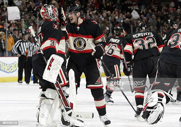 Tomas Kopecky of the Chicago Blackhawks thecelebrates with goalie Antti Niemi after winning in overtime against Dallas Stars on February 09 2010 at...