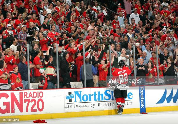 Tomas Kopecky of the Chicago Blackhawks throws his stick over the glass to fans in celebration of his teams 21 victory in Game Two of the 2010 NHL...