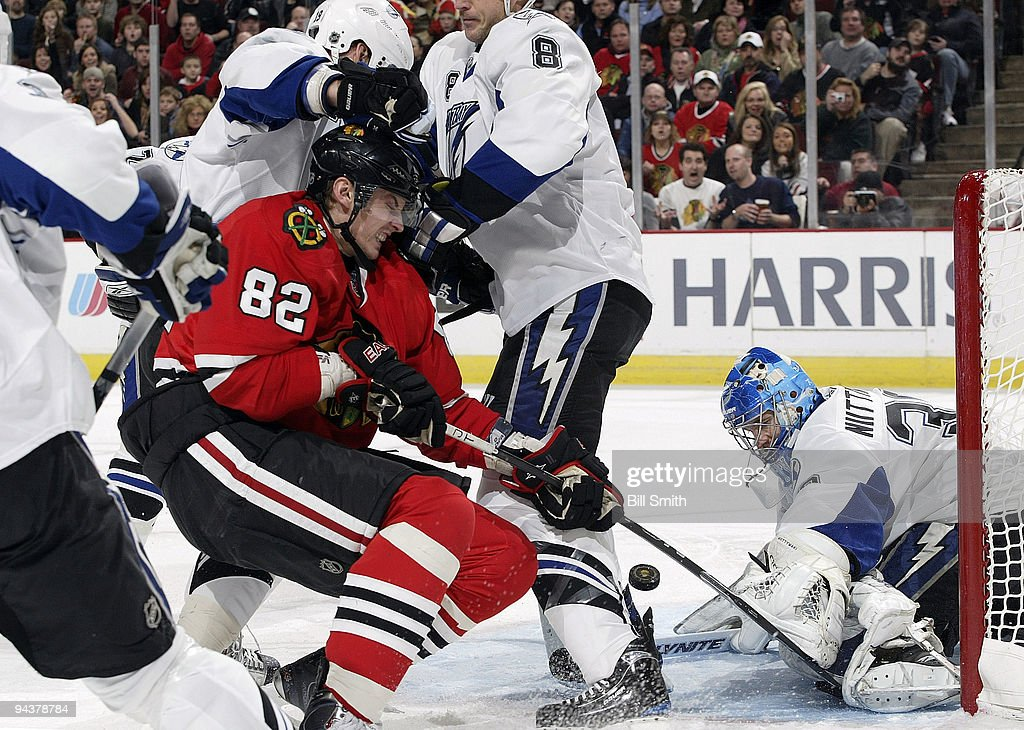 Tomas Kopecky of the Chicago Blackhawks tries to get the puck past goalie Antero Niittymaki of the Tampa Bay Lightning on December 13 2009 at the...