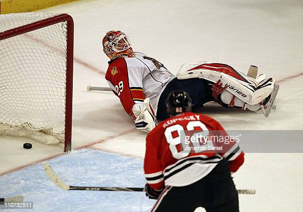 Tomas Kopecky of the Chicago Blackhawks watches the puck go into the net as Tomas Vokoun of the Florida Panthers lays on the ice out of the crease at...