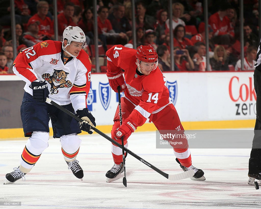 <a gi-track='captionPersonalityLinkClicked' href=/galleries/search?phrase=Tomas+Kopecky&family=editorial&specificpeople=2234349 ng-click='$event.stopPropagation()'>Tomas Kopecky</a> #82 of the Florida Panthers and <a gi-track='captionPersonalityLinkClicked' href=/galleries/search?phrase=Gustav+Nyquist&family=editorial&specificpeople=5491209 ng-click='$event.stopPropagation()'>Gustav Nyquist</a> #14 of the Detroit Red Wings go for the puck off a face-off during an NHL game at Joe Louis Arena on December 7, 2013 in Detroit, Michigan.