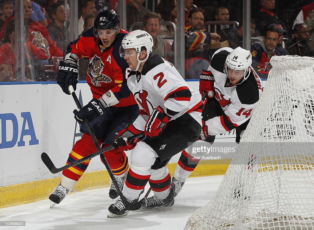<a gi-track='captionPersonalityLinkClicked' href=/galleries/search?phrase=Tomas+Kopecky&family=editorial&specificpeople=2234349 ng-click='$event.stopPropagation()'>Tomas Kopecky</a> #82 of the Florida Panthers battles behind the net with <a gi-track='captionPersonalityLinkClicked' href=/galleries/search?phrase=Marek+Zidlicky&family=editorial&specificpeople=203291 ng-click='$event.stopPropagation()'>Marek Zidlicky</a> #2 and Adam Henrique #14 of the New Jersey Devils in Game Two of the Eastern Conference Quarterfinals during the 2012 NHL Stanley Cup Playoffs at the BankAtlantic Center on April 15, 2012 in Sunrise, Florida. The Panthers defeated the Devils 4-2.