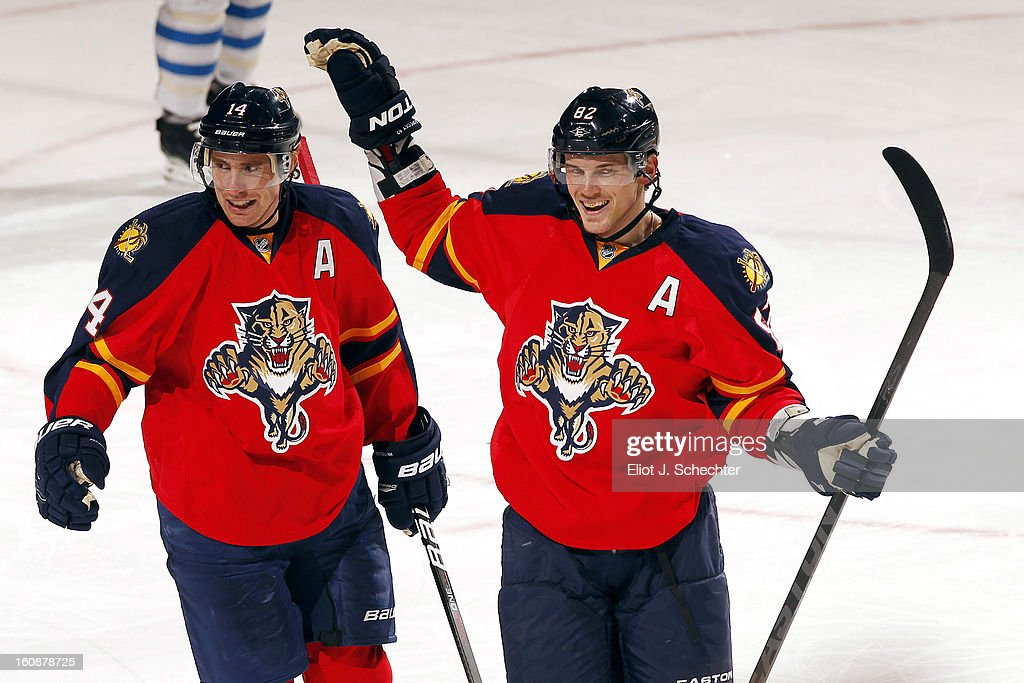Tomas Kopecky #82 of the Florida Panthers celebrates a goal with teammate Tomas Fleischmann #14 against the Winnipeg Jets at the BB&T Center on January 31, 2013 in Sunrise, Florida.