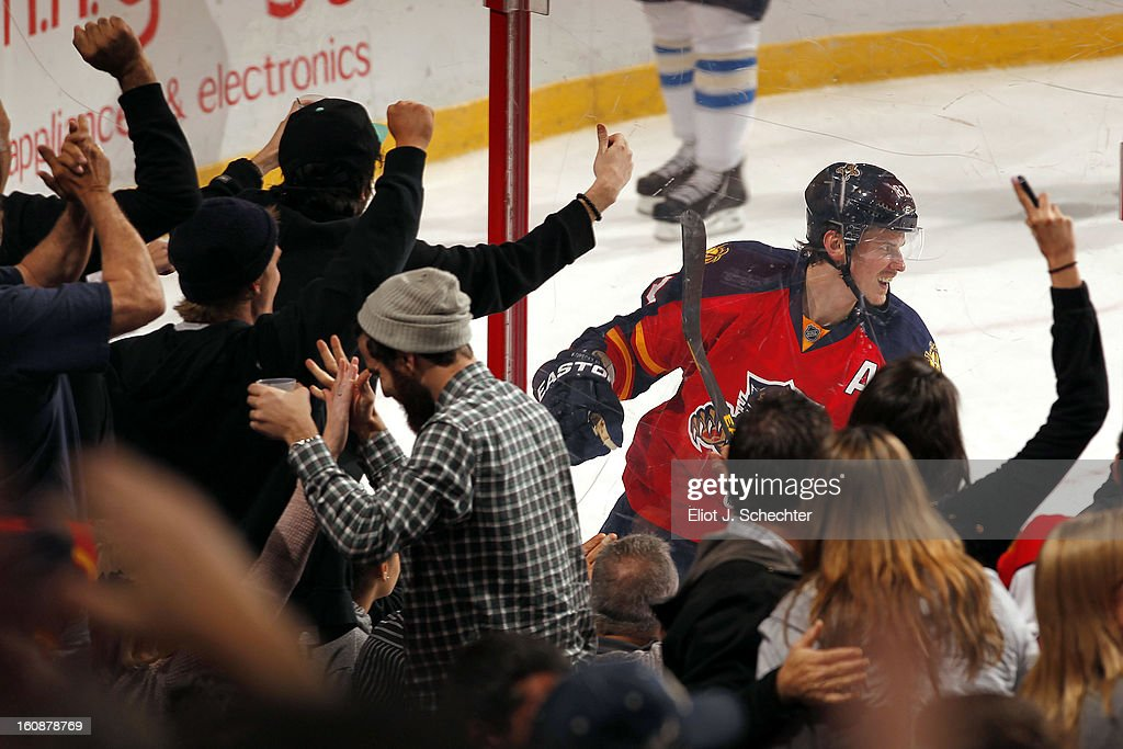 Tomas Kopecky #82 of the Florida Panthers celebrates his goal while fans cheer against the Winnipeg Jets at the BB&T Center on January 31, 2013 in Sunrise, Florida.