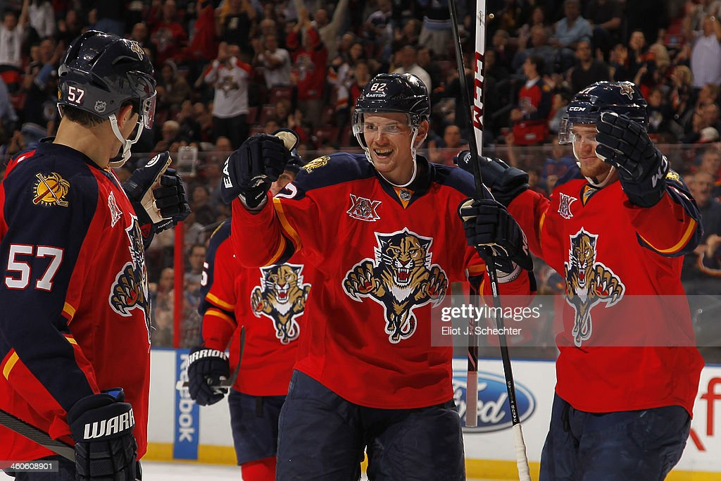 <a gi-track='captionPersonalityLinkClicked' href=/galleries/search?phrase=Tomas+Kopecky&family=editorial&specificpeople=2234349 ng-click='$event.stopPropagation()'>Tomas Kopecky</a> #82 of the Florida Panthers celebrates his goal with teammates against the Nashville Predators at the BB&T Center on January 4, 2014 in Sunrise, Florida.