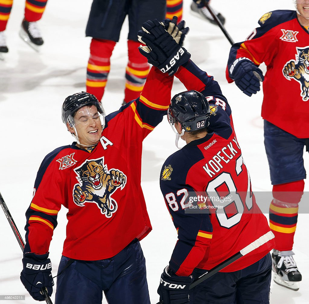 <a gi-track='captionPersonalityLinkClicked' href=/galleries/search?phrase=Tomas+Kopecky&family=editorial&specificpeople=2234349 ng-click='$event.stopPropagation()'>Tomas Kopecky</a> #82 of the Florida Panthers celebrates their shoot out win with teammate <a gi-track='captionPersonalityLinkClicked' href=/galleries/search?phrase=Scottie+Upshall&family=editorial&specificpeople=209198 ng-click='$event.stopPropagation()'>Scottie Upshall</a> #19 against the Washington Capitals at the BB&T Center on December 13, 2013 in Sunrise, Florida.