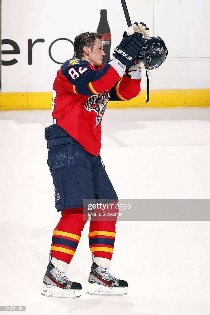 Tomas Kopecky #82 of the Florida Panthers celebrates with fans his hat trick after beating the Pittsburgh Penguins 6-4 at the BB&T Center on February 26, 2013 in Sunrise, Florida.