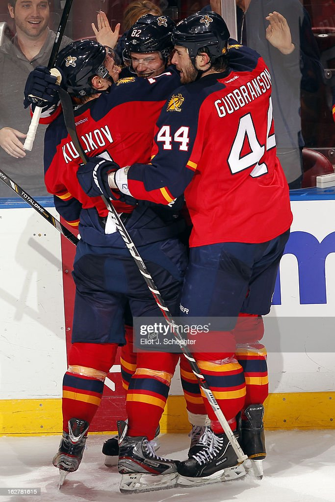 <a gi-track='captionPersonalityLinkClicked' href=/galleries/search?phrase=Tomas+Kopecky&family=editorial&specificpeople=2234349 ng-click='$event.stopPropagation()'>Tomas Kopecky</a> #82 of the Florida Panthers celebrates with teammates his hat trick against the Pittsburgh Penguins at the BB&T Center on February 26, 2013 in Sunrise, Florida.