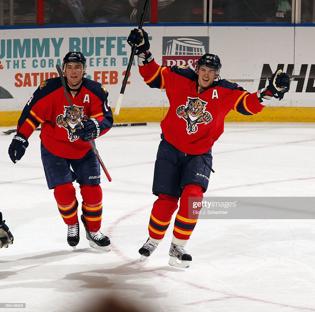<a gi-track='captionPersonalityLinkClicked' href=/galleries/search?phrase=Tomas+Kopecky&family=editorial&specificpeople=2234349 ng-click='$event.stopPropagation()'>Tomas Kopecky</a> #82 of the Florida Panthers clebrates a goal with teammate <a gi-track='captionPersonalityLinkClicked' href=/galleries/search?phrase=Tomas+Fleischmann&family=editorial&specificpeople=554398 ng-click='$event.stopPropagation()'>Tomas Fleischmann</a> #14 against the Winnipeg Jets at the BB&T Center on January 31, 2013 in Sunrise, Florida.