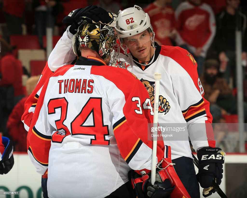 <a gi-track='captionPersonalityLinkClicked' href=/galleries/search?phrase=Tomas+Kopecky&family=editorial&specificpeople=2234349 ng-click='$event.stopPropagation()'>Tomas Kopecky</a> #82 of the Florida Panthers congratulates teammate Tim Thomas #34 after winning an NHL game against the Detroit Red Wings at Joe Louis Arena on December 7, 2013 in Detroit, Michigan. Florida defeated Detroit 2-1