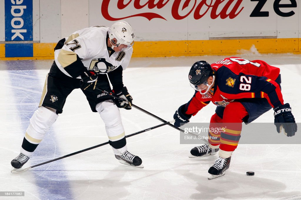 <a gi-track='captionPersonalityLinkClicked' href=/galleries/search?phrase=Tomas+Kopecky&family=editorial&specificpeople=2234349 ng-click='$event.stopPropagation()'>Tomas Kopecky</a> #82 of the Florida Panthers crosses sticks with <a gi-track='captionPersonalityLinkClicked' href=/galleries/search?phrase=Evgeni+Malkin&family=editorial&specificpeople=221676 ng-click='$event.stopPropagation()'>Evgeni Malkin</a> #71 of the Pittsburgh Penguins at the BB&T Center on October 11, 2013 in Sunrise, Florida.