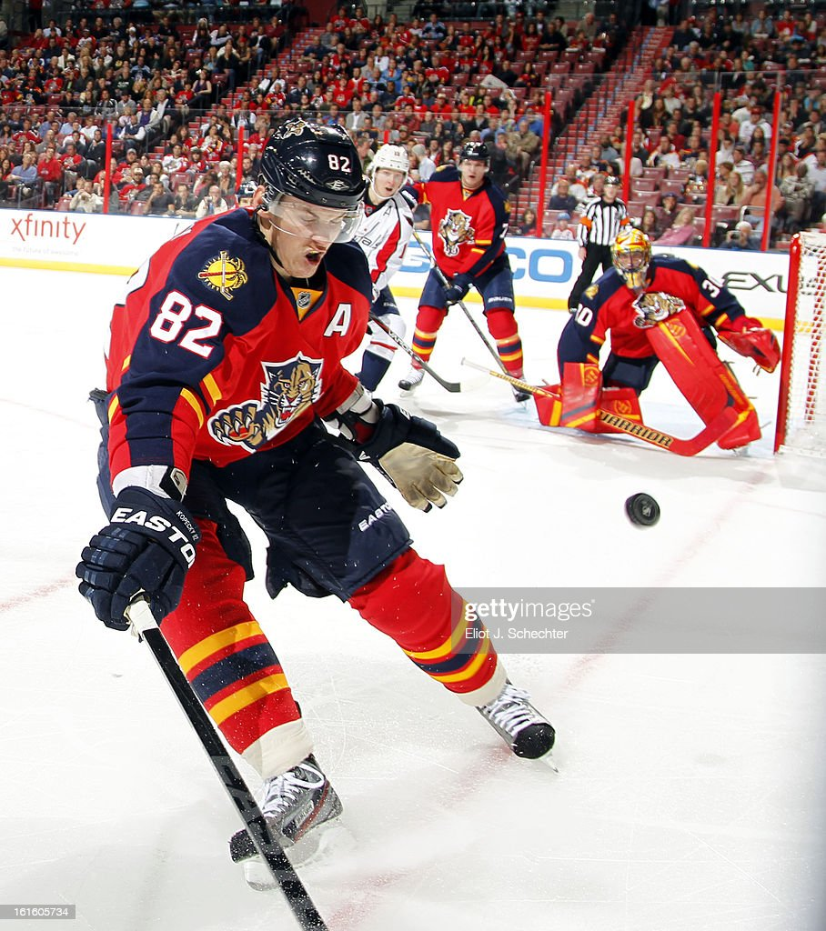 Tomas Kopecky #82 of the Florida Panthers digs the puck out from the boards against the Washington Capitals at the BB&T Center on February 12, 2013 in Sunrise, Florida.