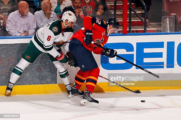 Tomas Kopecky of the Florida Panthers digs the puck out from the boards against Marco Scandella of the Minnesota Wild at the BBT Center on October 19...
