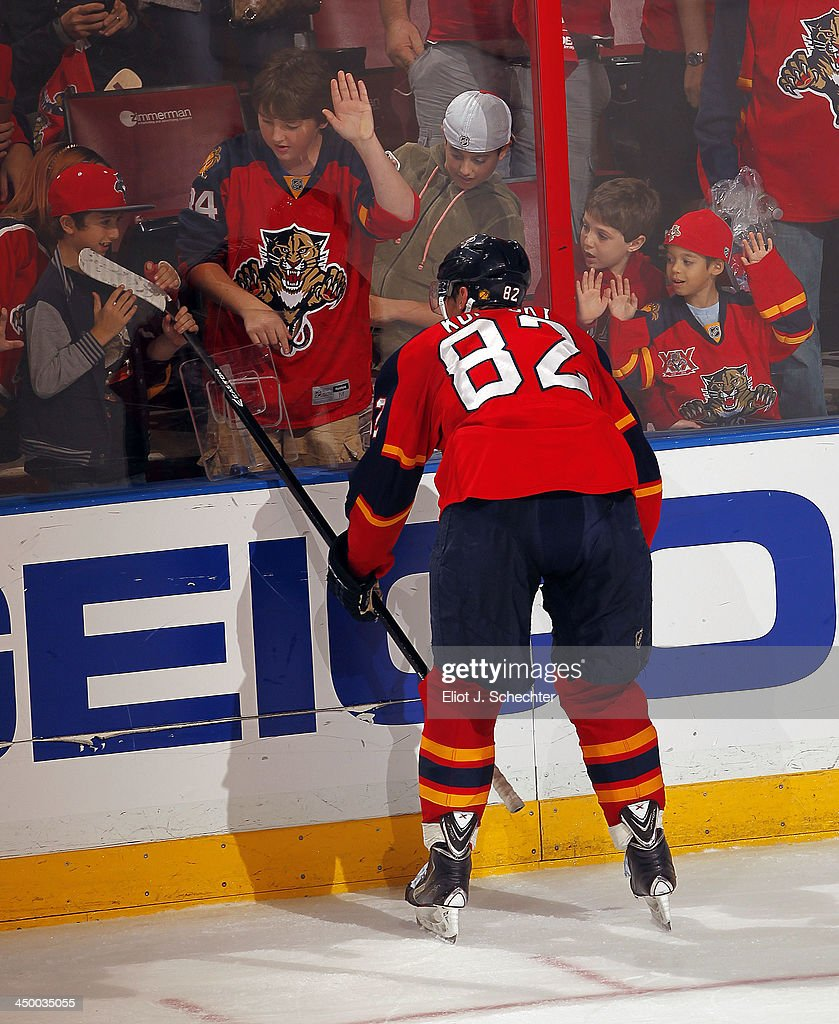 Tomas Kopecky #82 of the Florida Panthers gives a fan his stick after a win against the Anaheim Ducks at the BB&T Center on November 12, 2013 in Sunrise, Florida.
