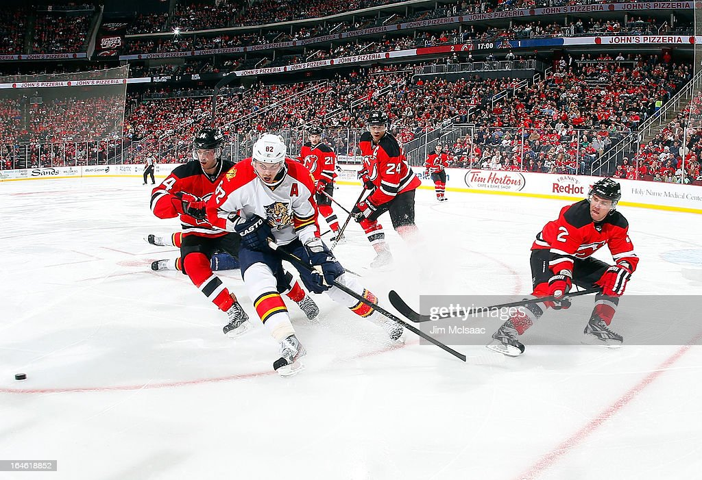 <a gi-track='captionPersonalityLinkClicked' href=/galleries/search?phrase=Tomas+Kopecky&family=editorial&specificpeople=2234349 ng-click='$event.stopPropagation()'>Tomas Kopecky</a> #82 of the Florida Panthers in action against <a gi-track='captionPersonalityLinkClicked' href=/galleries/search?phrase=Marek+Zidlicky&family=editorial&specificpeople=203291 ng-click='$event.stopPropagation()'>Marek Zidlicky</a> #2 of the New Jersey Devils at the Prudential Center on March 23, 2013 in Newark, New Jersey. The Devils defeated the Panthers 2-1.