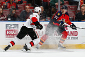 Tomas Kopecky of the Florida Panthers prepares to be checked by Chris Phillips of the Ottawa Senators at the BBT Center on October 13 2014 in Sunrise...