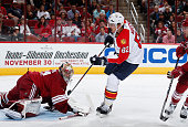 Tomas Kopecky of the Florida Panthers shoots the puck on goaltender Mike Smith of the Arizona Coyotes during the NHL game at Gila River Arena on...