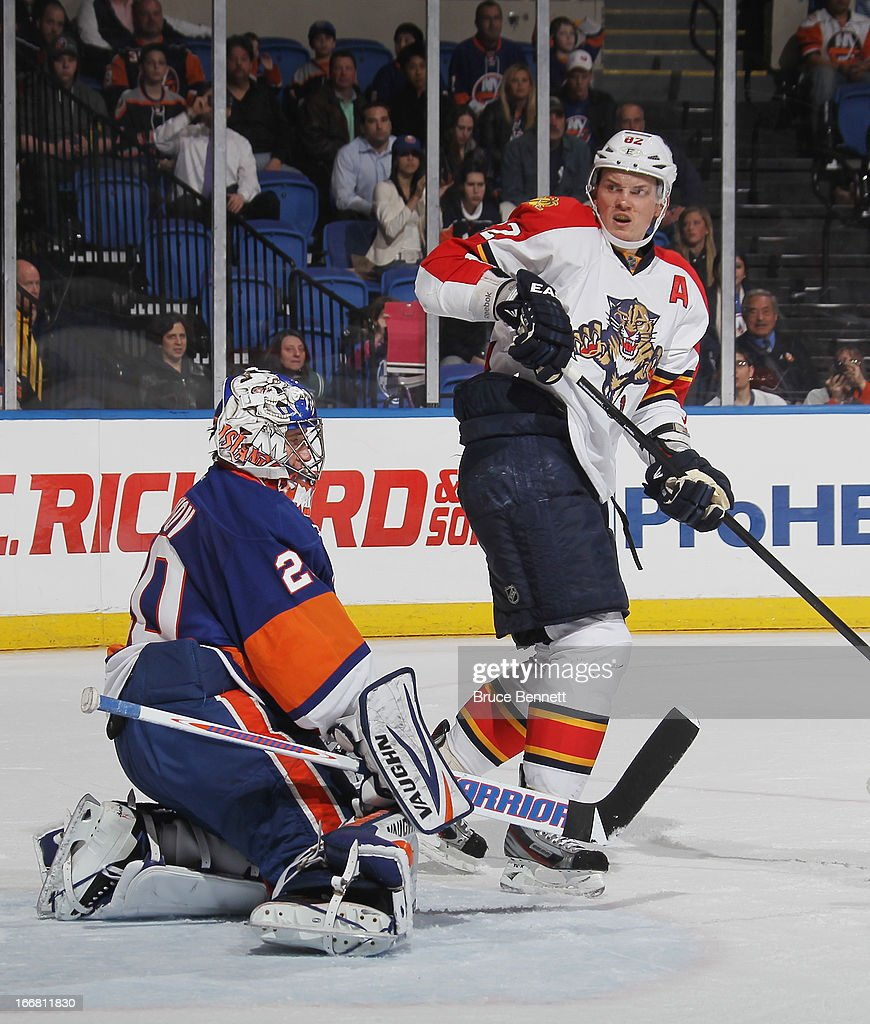 <a gi-track='captionPersonalityLinkClicked' href=/galleries/search?phrase=Tomas+Kopecky&family=editorial&specificpeople=2234349 ng-click='$event.stopPropagation()'>Tomas Kopecky</a> #82 of the Florida Panthers skates against <a gi-track='captionPersonalityLinkClicked' href=/galleries/search?phrase=Evgeni+Nabokov&family=editorial&specificpeople=171380 ng-click='$event.stopPropagation()'>Evgeni Nabokov</a> #20 of the New York Islanders at the Nassau Veterans Memorial Coliseum on April 16, 2013 in Uniondale, New York. The Islanders defeated the Panthers 5-2.