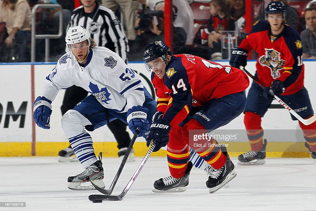 Tomas Kopecky #82 of the Florida Panthers skates for the puck against Michael Kostka #53 of the Toronto Maple Leafs at the BB&T Center on April 25, 2013 in Sunrise, Florida.