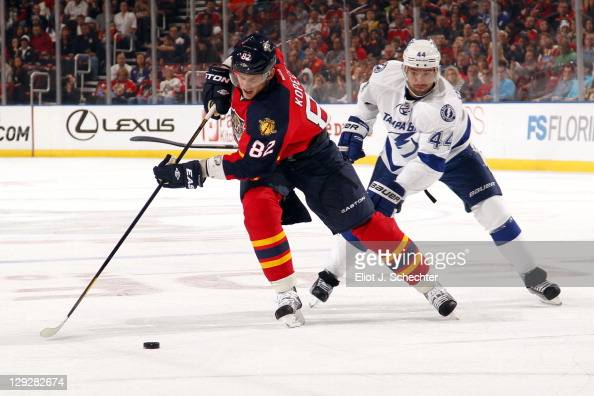 Tomas Kopecky of the Florida Panthers skates with the puck against Nate Thompson of the Tampa Bay Lightning at the BankAtlantic Center on October 15...