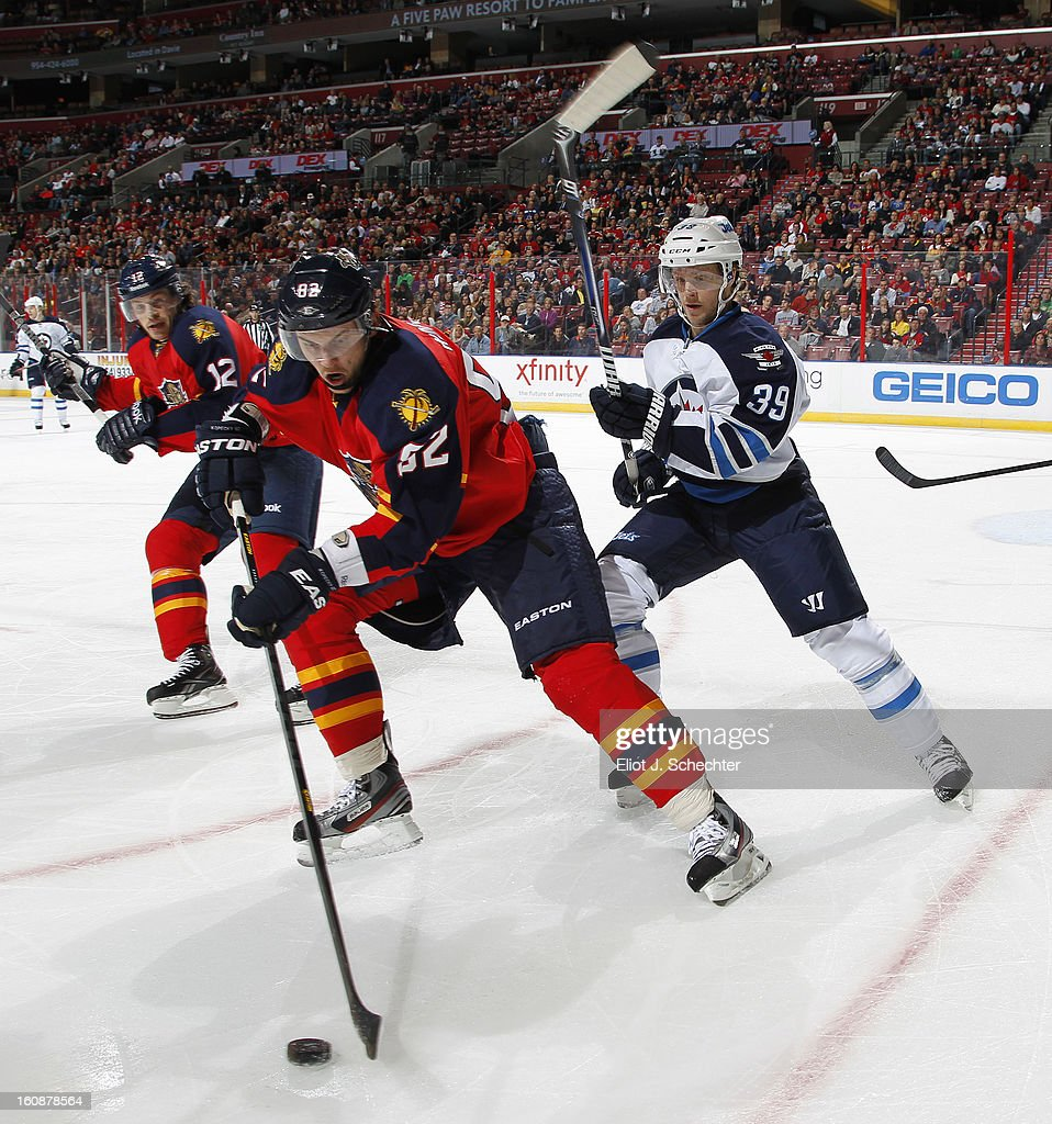 Tomas Kopecky #82 of the Florida Panthers skates with the puck against Tobias Enstrom #39 of the Winnipeg Jets at the BB&T Center on January 31, 2013 in Sunrise, Florida.