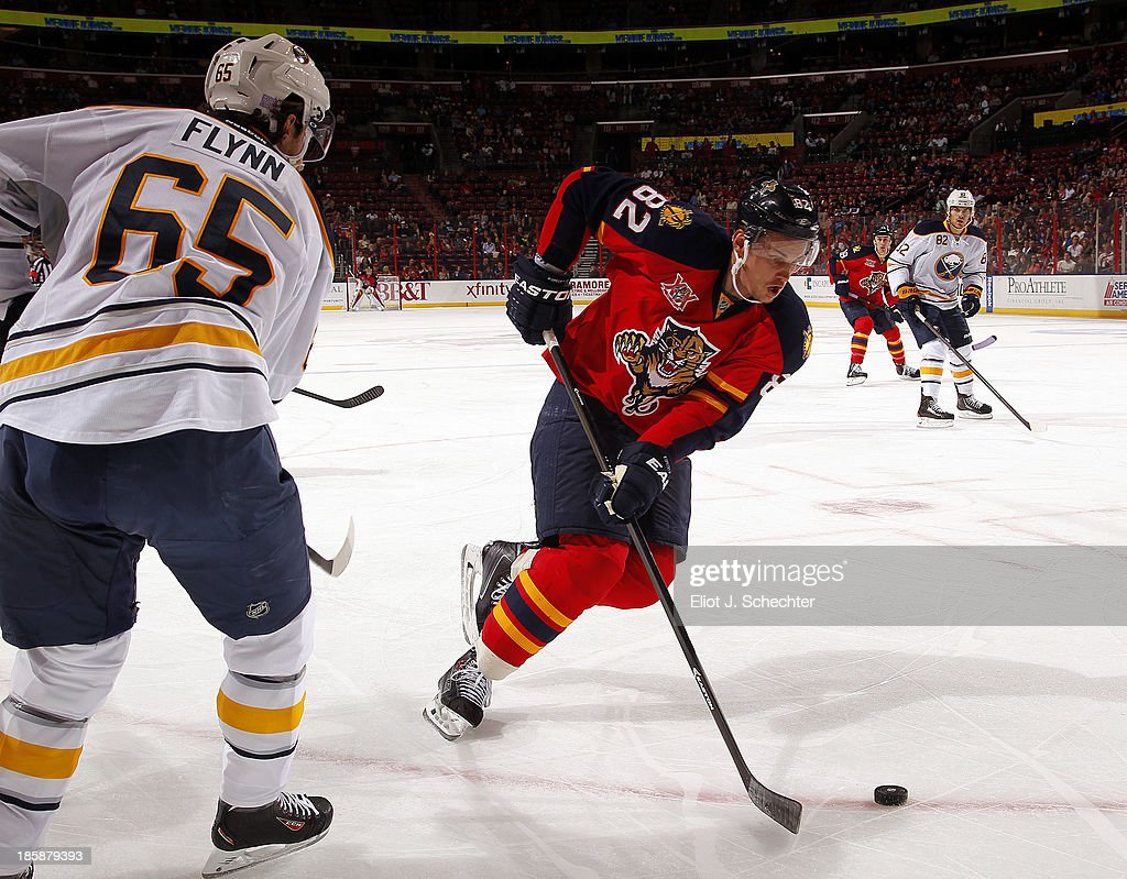 Tomas Kopecky #82 of the Florida Panthers skates with the puck against Brian Flynn #65 of the Buffalo Sabres at the BB&T Center on October 25, 2013 in Sunrise, Florida.