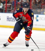 Tomas Kopecky of the Florida Panthers skates with the puck against the San Jose Sharks at the BBT Center on January 16 2014 in Sunrise Florida