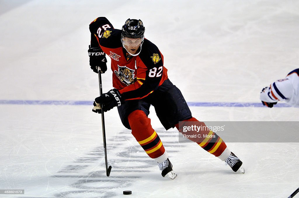Tomas Kopecky #82 of the Florida Panthers skates with the puck during a NHL game against the Edmonton Oilers at the BB&T Center on November 5, 2013 in Sunrise, Florida.